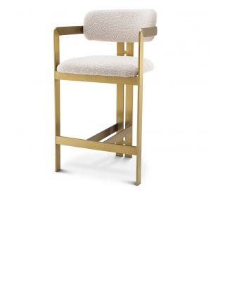Silla de barra Donato de Eichholtz con acabado latón cepillado y tapiceria Bouclé crema